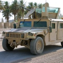 U.S. HMMWV kicking up dust in Iraq.